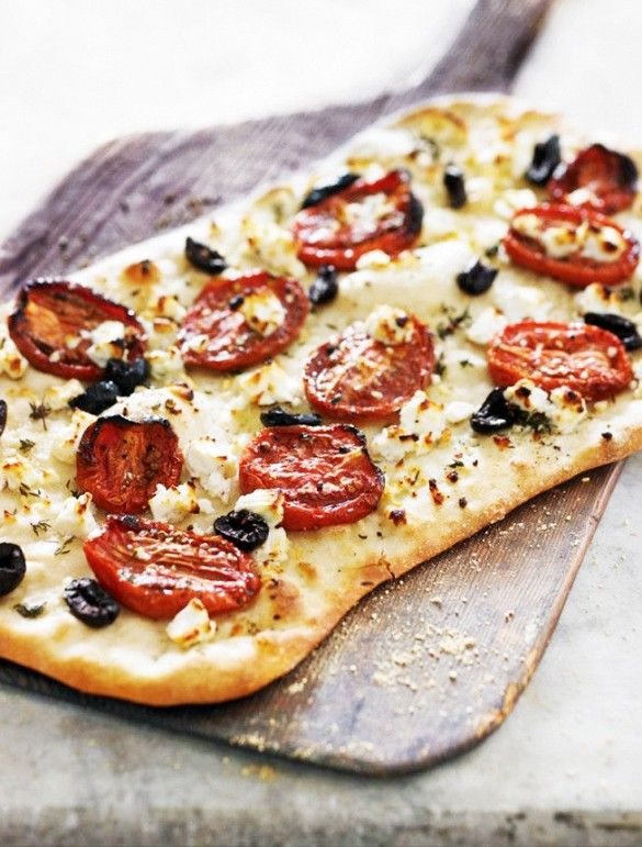 Flatbread with feta, thyme, and oven-roasted tomatoes.