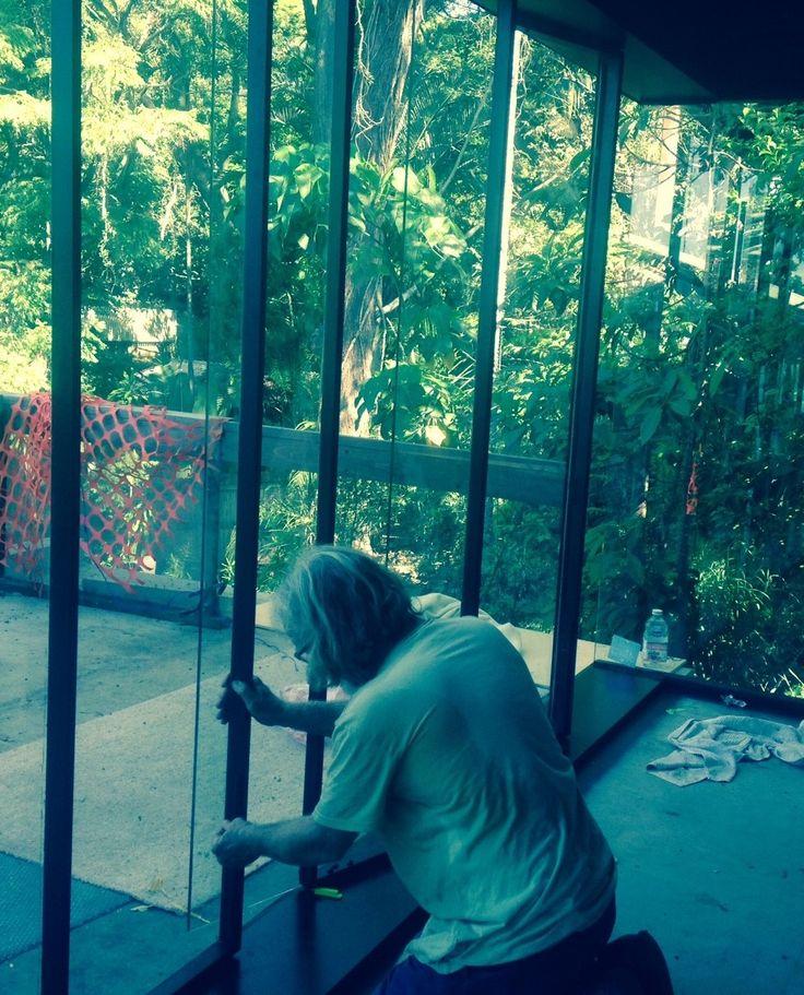 Steel framed glass pivot window Installation - Evan Goldsmith Joinery - Red Hill Residence - TWOFOLD STUDIO/JONES ARCHITECTS