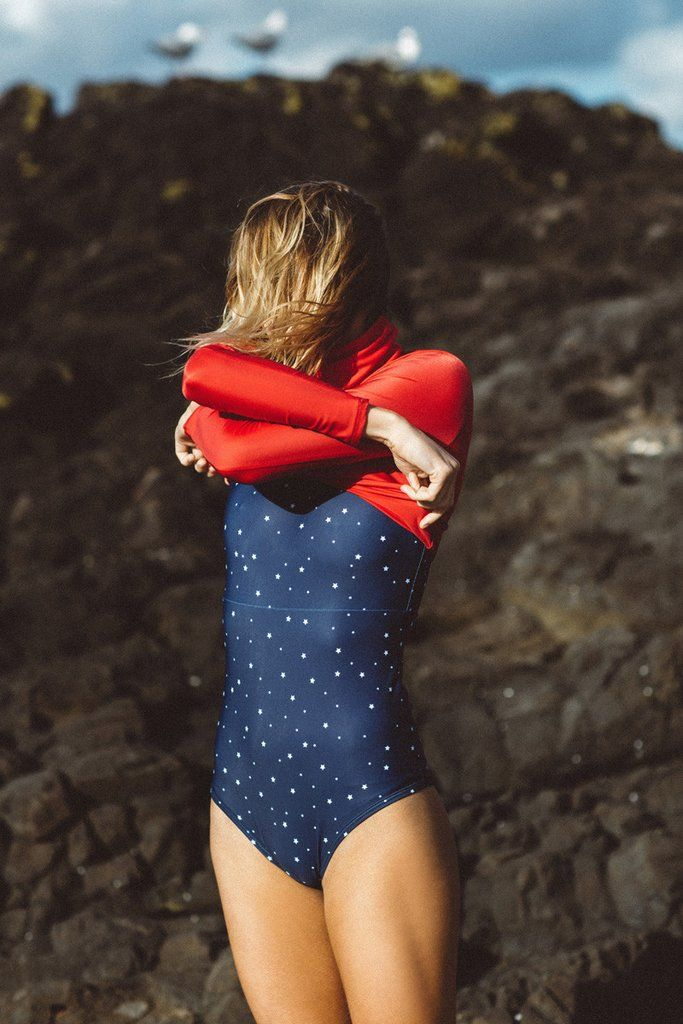Lower wears Salt Gypsy sustainable ocean activewear. The Navy & Gold Montana Collection 2017 | www.saltgypsy.com #saltgypsy #activewear #activeswim #beachactive #womenwhosurf #surf #sustainableswim
