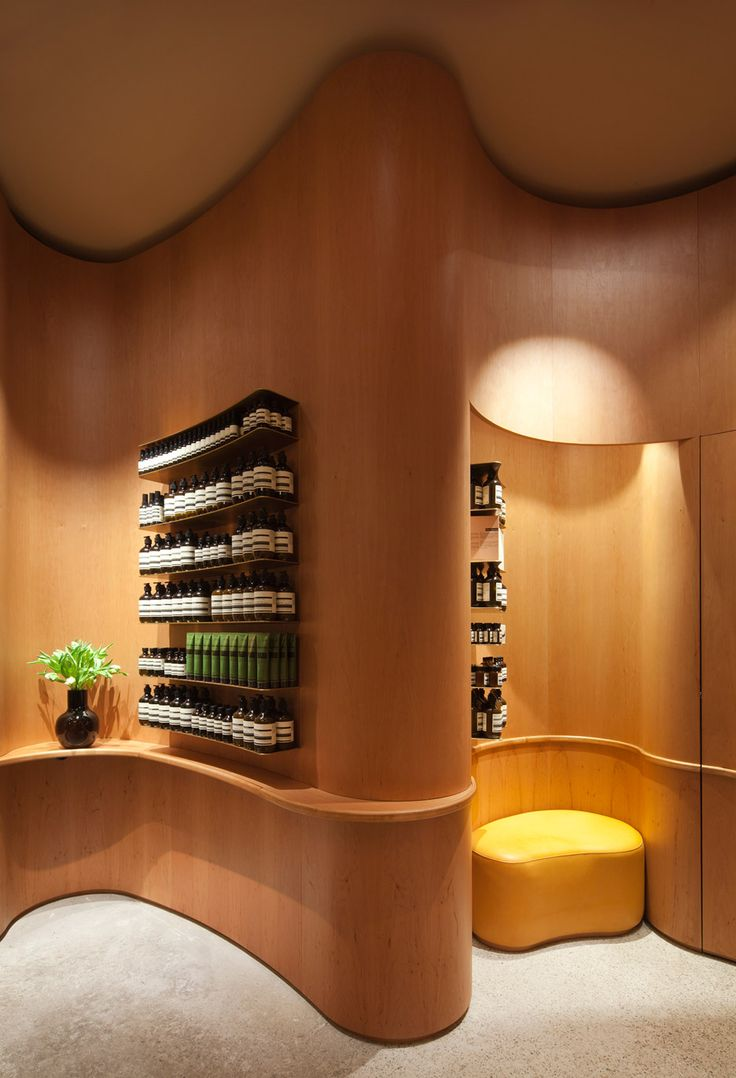 Aesop's Stockholm store features curved wooden walls inspired by the designs of Swedish architect Erik Gunnar Asplund