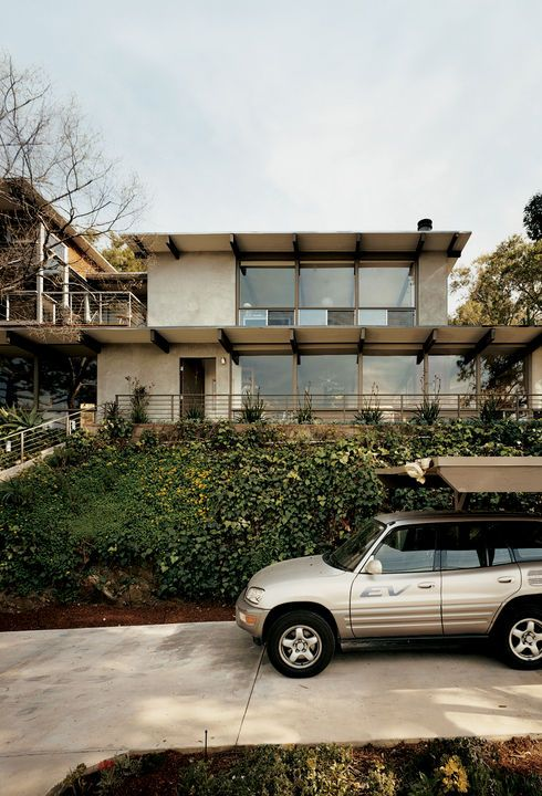Los Angeles is not all mini-malls and highways. As Mayor Eric Garcetti shows, it is eminently possible to live green in the City of Angels. By putting solar power and recycled materials to use, he and his partner transformed a mid-century house on a cozy hillside plot into a sustainable home with garden terraces and panoramic views. Garcetti's old Toyota Rav4-EV sits in front of the house, awaiting its next electric fill-up. Photo by Misha Gravenor.  Photo by Misha Gravenor.   This ...