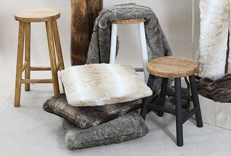 Solid wooden Turner Stools and luxurious Faux Fur Cushions and throws