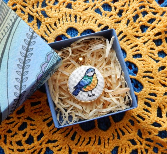"""The pendant """"Tomtit"""" is handmade item with #miniature #crossstitch (size of one microstitch is less than 1mm). Size of pendant 29x29mm, colour of the frame is gold. The penda... #tomtit #bird #blue #jewelry #gift #spring"""