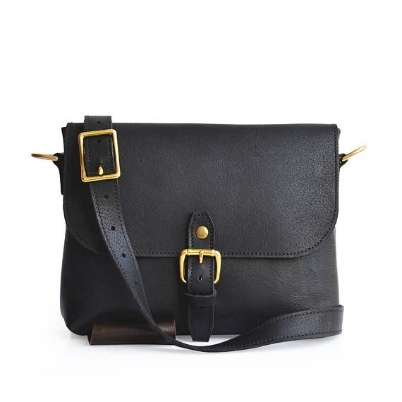The Solid Leather Company Slimline Purse is a great everyday carry bag for ladies (and even for men who just need something small for transporting their daily essentials). The Slimline Purse features a single strap/buckle closure. When the flap is opened it reveals a single unlined compartment. The main compartment features plenty of room to accommodate an iPad Mini or similar device. It will also still have room for books, journals, your wallet, and other necessary essentials. On the ou...