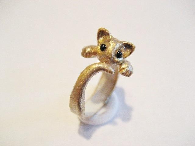 Absolutely adorable kitten wraparound ring. $14.75, via Etsy.