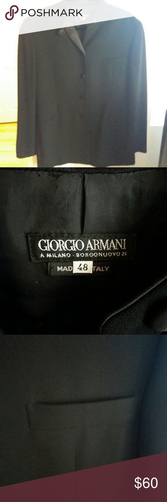 Ladies black button front Giorgio Armani jacket. Size 48. Made in Italy. Matching cloth buttons, bottom one missing. Front pocket, deep dark black. Measures 34.5 inches from top to bottom, 20.5 inches from underarm to underarm. Long dressy jacket, would be great fancy or with jeans. Giorgio Armani Jackets & Coats Blazers