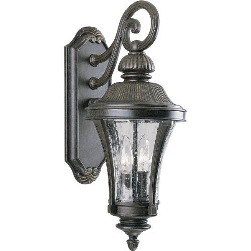 Progress Lighting P5836-77 2-Light Wall Lantern with Water Glass Panels, Forged Bronze by Progress Lighting. $193.14. From the Manufacturer                Stately and architectural for a uniquely distinctive presence, the Nottington Collection features handsome cast details and clear, water glass panels. Durable cast aluminum construction is finishes is a rich hand painted finish. 2-Light wall lantern with water glass panels. Uses (2) 60-Watt candelabra bulbs 8-Inch Width...