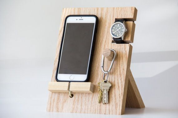 In the last entry we looked at your standard valet trays, which sit horizontal. But lately on Etsy there's been a rash of designs going vertical, either to provide better visibility or take up less tabletop real estate. They presumably evolved from simple phone holders like this one or that