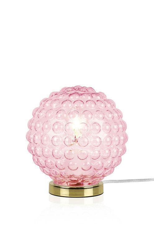 """Bordlampa """"Spring"""" är gjord i svagt färgat bubbligt 30-tals glas som ger en spännande ljusspridning. Fot i mässing och transparent sladd med brytare. Höjd 20 cm. Diameter 17 cm. Lamphållare E27. Max 40W. Design: Anna Andersson. Ljuskälla ingår ej.<br> <br><br>"""