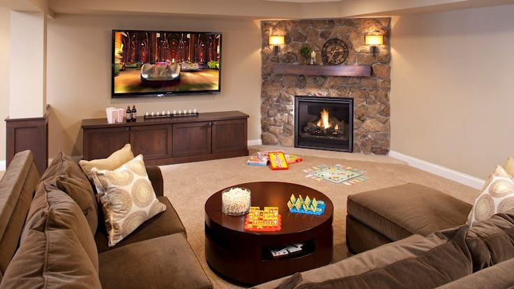 Built in bench creating space to hide board games and toys ispiri fireplaces pinterest for Living room design with corner fireplace