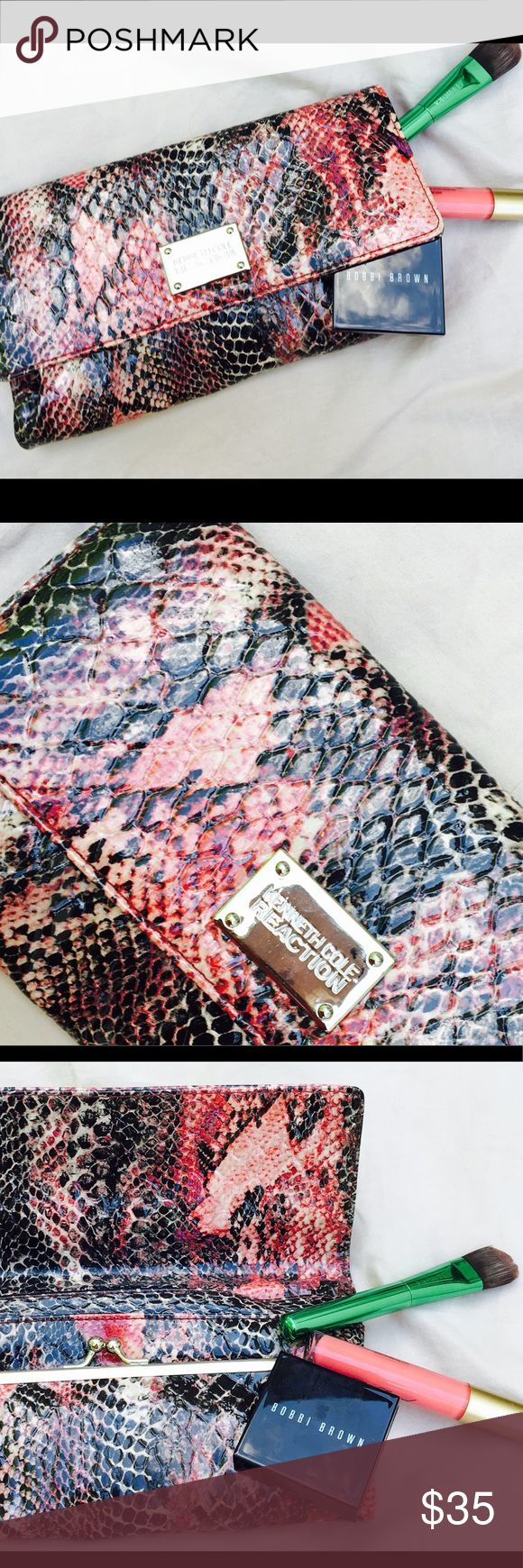 NWOT Kenneth Cole Reaction Faux Snake Skin Wallet. NWOT Kenneth Cole Reaction Faux Snake Skin Wallet.   Primary flap close with magnet, Shiny chrome-like metal logo badge, Kiss lock coin purse, 2 compartments with 4 credit card sized slip pockets. Perfect inside your purse yet big enough to use as a clutch on the go! Nordstrom Bags Wallets