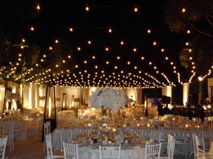 Ordinary tennis court transformed with Italian string lighting for a wedding . & Best 25+ Tennis court wedding ideas on Pinterest | Cheap wedding ... azcodes.com