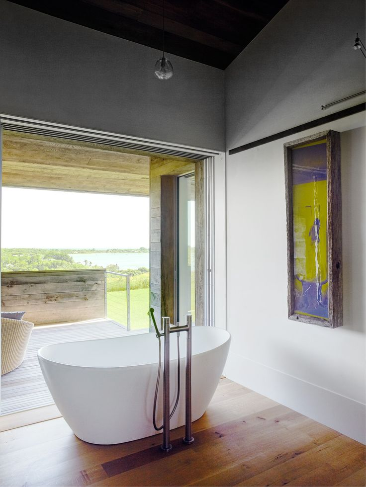 A freestanding bath with a rural view. | Photo: Richard Powers | Story: Belle