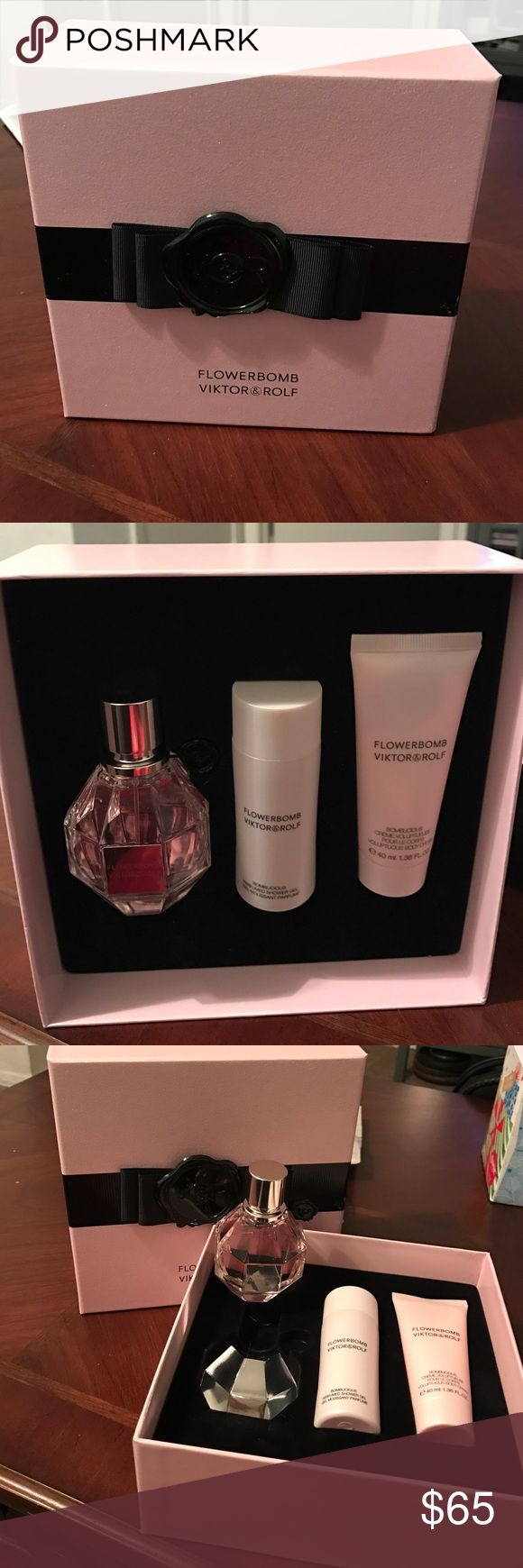 FLOWERBOMB Viktor &Rolf Set New perfume set;  the perfume is 1.7 FL OZ, and it also comes with a shower gel and body cream. Price if firm!!! Viktor & Rolf Accessories