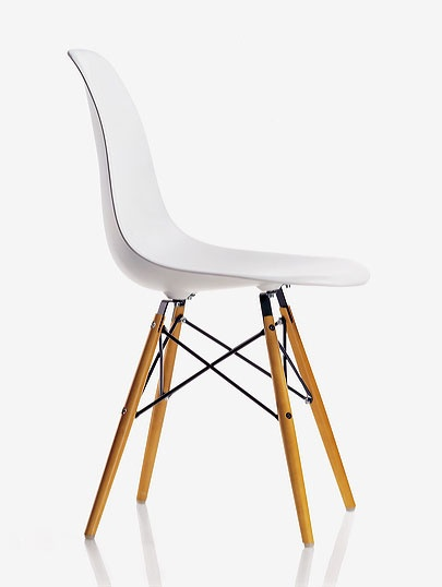 Eames.  These are the chairs I want for my dinning room.  I want to pair them with a rustic table for high contrast!    Ah....someday...