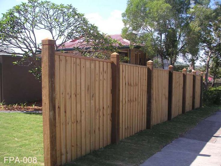 Hardwood posts, lap and cap paling fence
