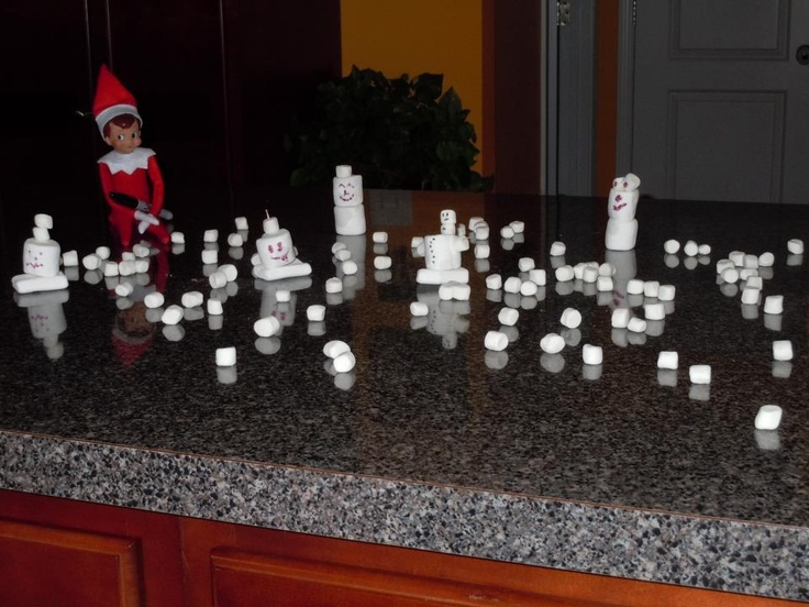 Day 8.  Bob thought it would be funny to have a snowball fight with some marshmallow men on our island in the kitchen.  He made a mess of the kitchen!!