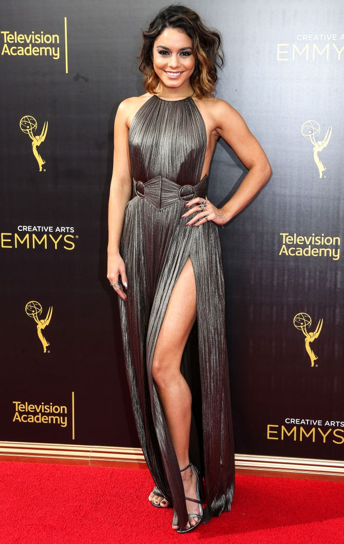 VANESSA HUDGENS  in a halter-style shiny metallic gown with thigh-high slit and Stuart Weitzman heels at the Creative Arts Emmy Awards in L.A.