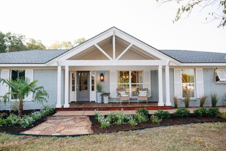 An unprepossessing brick house is transformed by Chip and Joanna Gaines - it's amazing the difference  it makes to paint the brick this beautiful, elegant grey