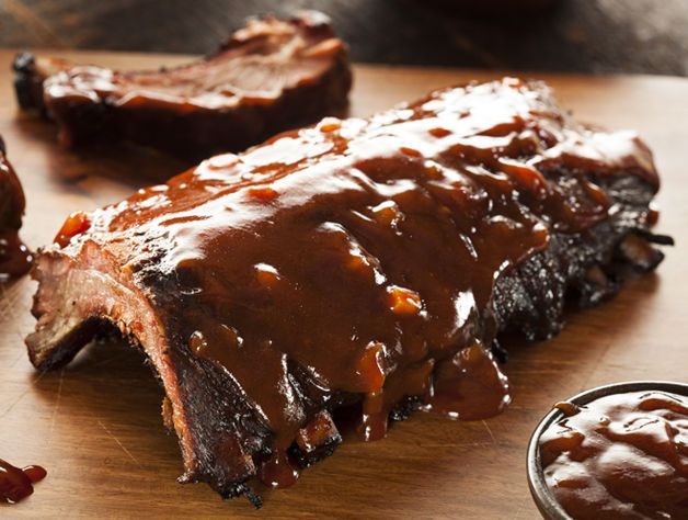 Browning the ribs in the pot seals in the flavor of the smokysweet spice rub, then steam roasting cooks the ribs until the meat is falling off the bone. Glazing with barbeque sauce to finish adds an extra layer of flavor.