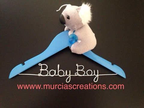 Coat Hanger. Adorable handmade blue hanger with wording in silver wire and a fluffy baby koala. The perfect gift idea for baby showers and newborns. $25. Aud.