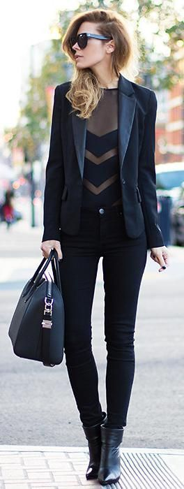 coat pants and lace shirt with long boots all in black