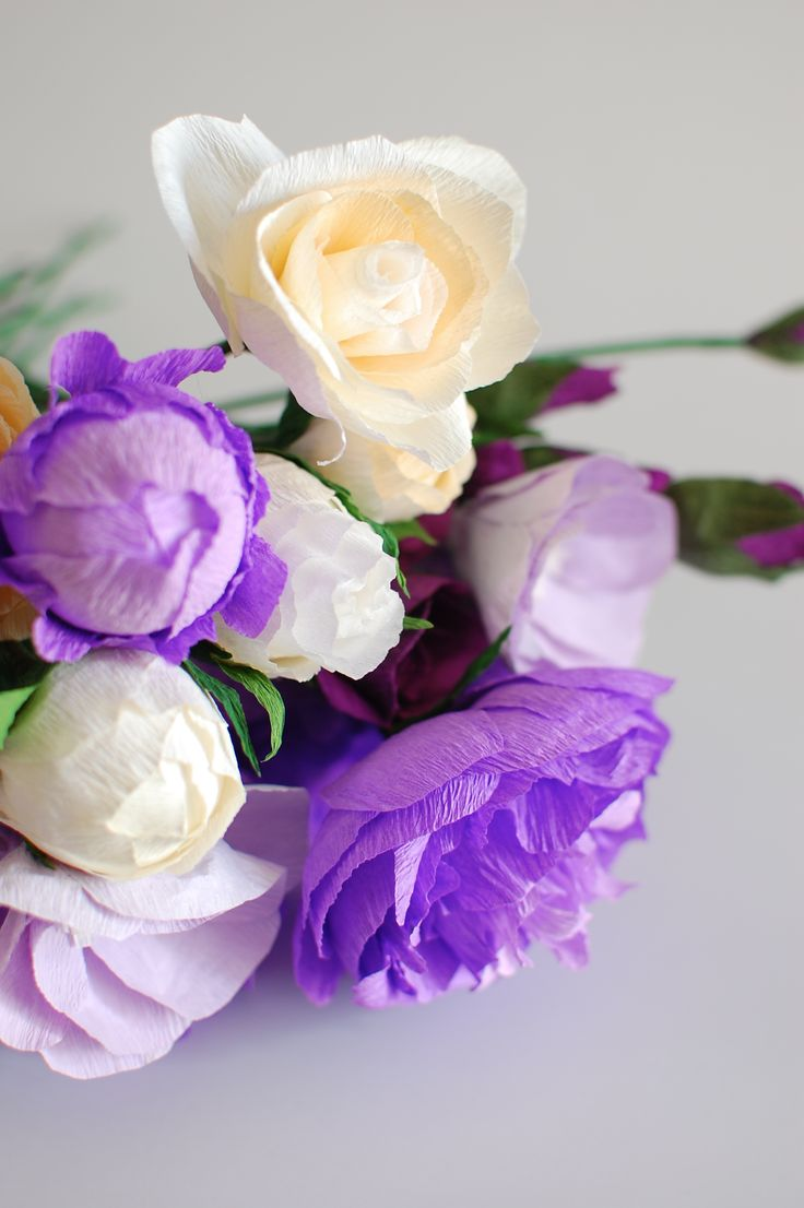 purple paper poeny and ivory paper rose.