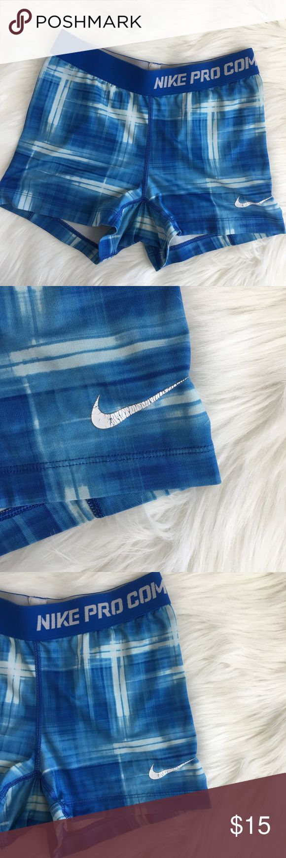 Nike Pro Combat Plaid Blue Spandex Nike pro spandex shorts. Great for sports. Worn but still have lots of life. Flaws shown in photos.  PET FREE HOME SMOKE FREE HOME OFFERS WELCOME QUICK SHIPPING CUTE PACKAGING 💕 ITEM #20 Nike Shorts