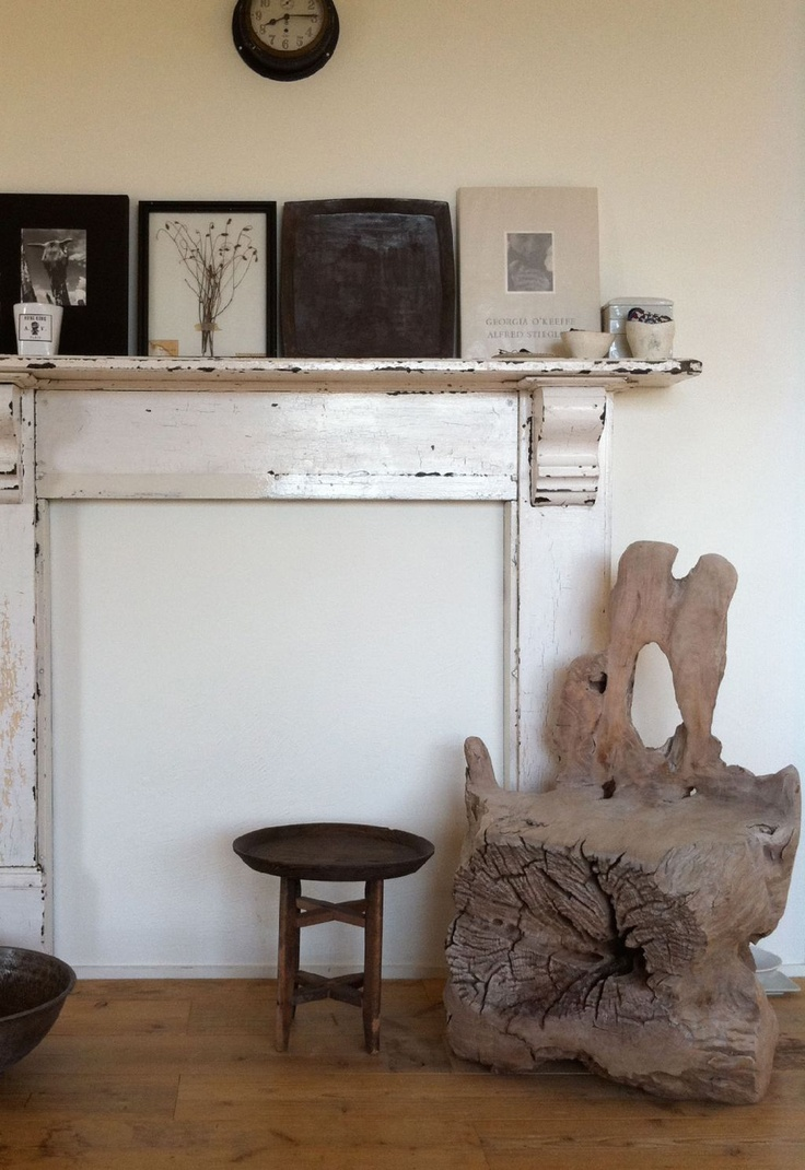 love the mantel and the clock and the art and the chair made from an old tree stump..