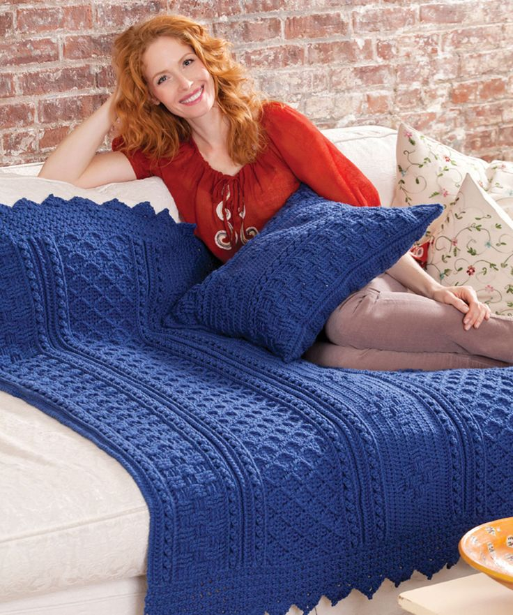 A traditional Aran stitch throw takes on modern sensibilities when crocheted in this clear shade of blue. Fashion your own unique version in any hue and add textural interest to your surroundings. Make the matching pillow first and try a sampling of all the different stitch patterns.