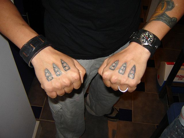 This guy had the coolest tattoos: receptacles for Wolverine's claws on the backs of his hands.     www.thetattoofanatic.com