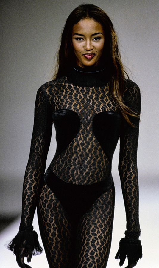 Naomi Campbell in gold studded Christian Louboutin heels ...  Naomi Campbell Alaia Dress