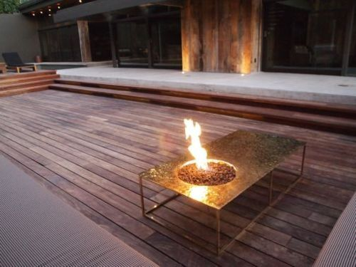 A fire bowl, comfortable outdoor seating and some structural grasses would work well.