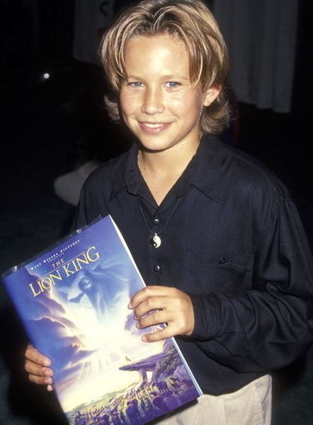 Well obviously a Lion King poster, cause he contractual obligation with Disney. | 23 Photos Of Jonathan Taylor Thomas Holding Things