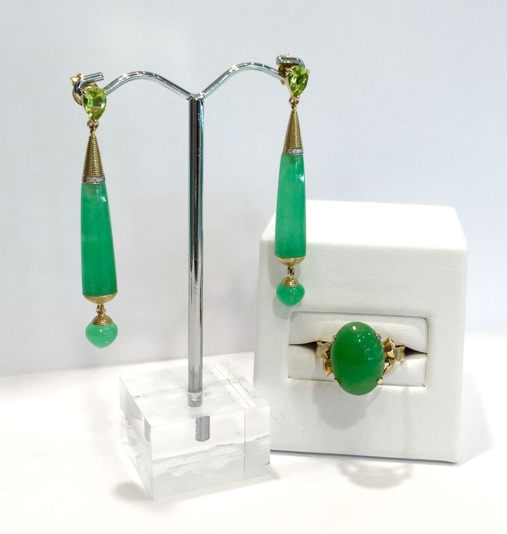 Featuring from left to right something old and something new: * 9ct yellow gold Jadeite peridot & diamond earrings (antique) * 14ct yellow gold Jadeite ring (new) Find out more about these pieces by sending an enquiry through our website.