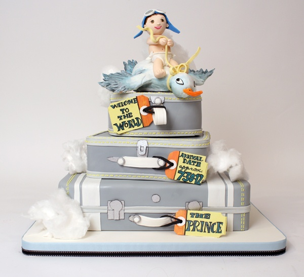 Baby Shower Cake by Charm City Cakes - Announce the arrival of your little bundle of joy with this non-traditional baby shower cake! Suitcases stacked three layers high with an aviator baby riding a stork on top!