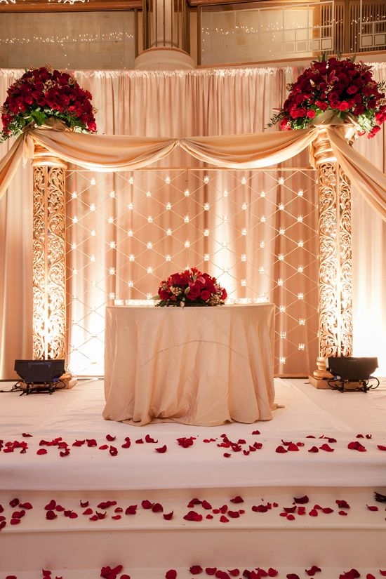 Elegant cream decor, with beautiful, romantic red roses. #indian #wedding #stage