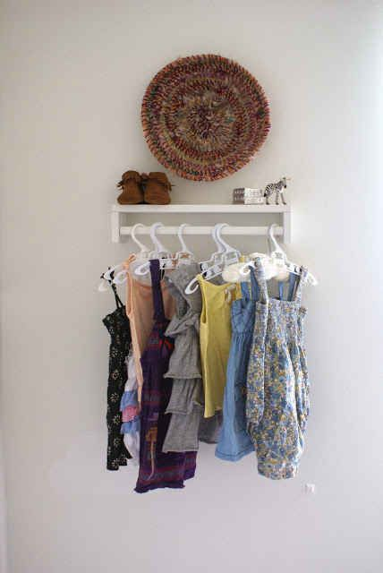 Use a spice rack as a clothing rack for baby clothes.