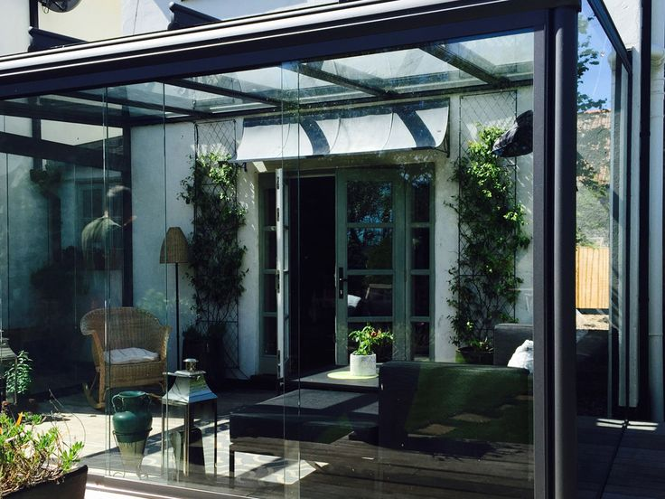 Glass room with large glass construction, allowing for great views of the garden - Build completed by OpenSpace Living
