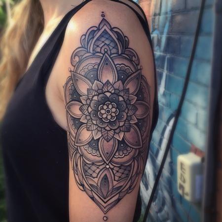 Laura Jade - Ornamental mandala arm tattoo