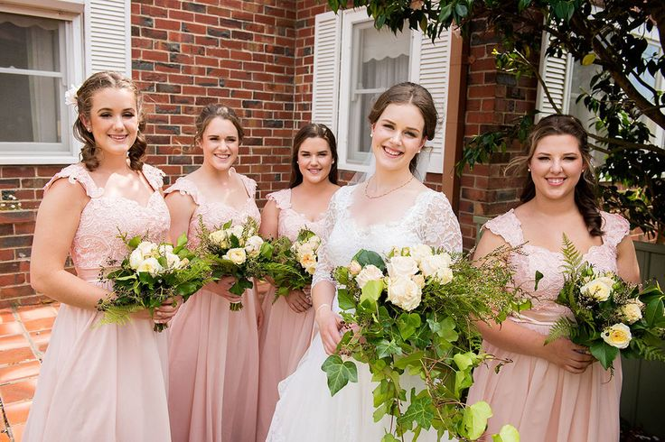 The gorgeous bride and her bridesmaids in Nan's front garden.