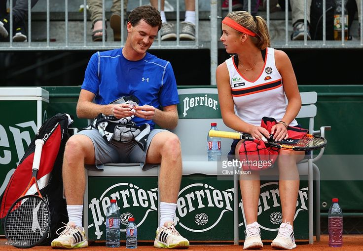 Jamie Murray of Great Britain and Elina Svitolina of Ukraine look on during a break in play in their Mixed Doubles match against Alicja Rosolska of Poland and Raven Klaasen of South Africa on day six of the 2015 French Open at Roland Garros on May 29, 2015 in Paris, France.