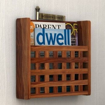 Buy #Nigra #Magazine #Rack (Teak Finish) online at reasonable prices and dazzling designs only at Wooden Street. Keep your favourite magazines close at hand with our beautifully designed stylish wooden magazine racks. Shop for great deals on magazine racks @ https://www.woodenstreet.com/magazine-rack