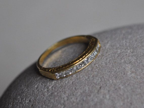 Gorgeous vintage eternity ring, c1920s. Ten high quality square cut diamonds, all in perfect condition, channel set within 18ct gold engraved setting. Gold is a lovely rich buttery colour. Good vintage condition. Size J (UK).