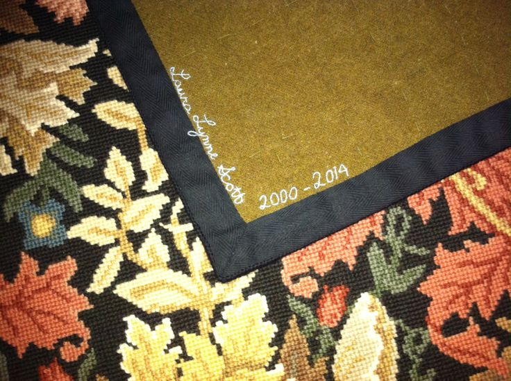 Needlepoint rug backing. William Morris Compton, Beth Russell needlepoint. Used old army blanket for backing.