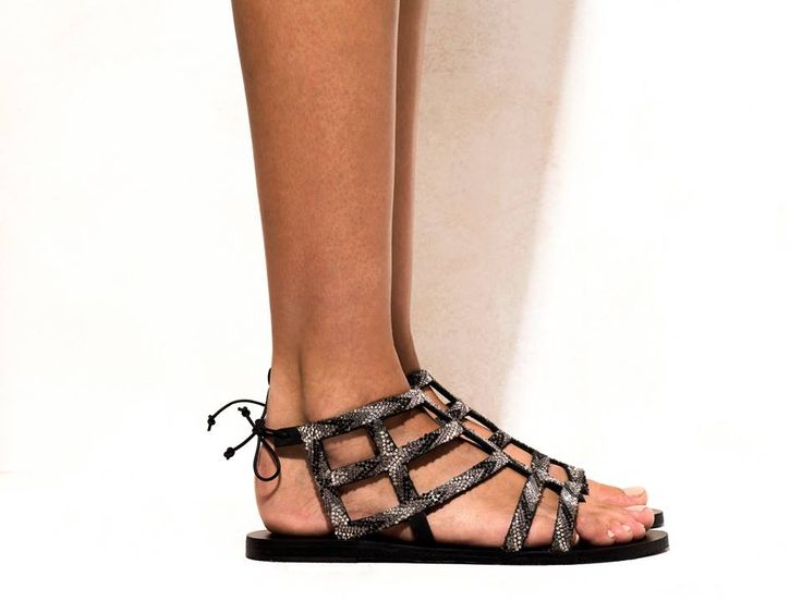 Oceanides Black  Sandals decorated with glass crystals, tied with a small leather lace.  Get the experience: http://www.elinalinardaki.com/shoes/sandals/new-collection/sandal-oceanides-black/