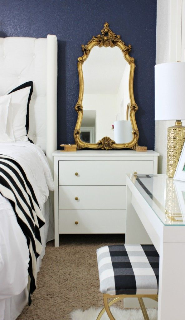 Love this vanity area and this whole bedroom! The link is how to recover a seat cushion and a Buffalo Check Stool Makeover - Click for tutorial - www.classyclutter.net