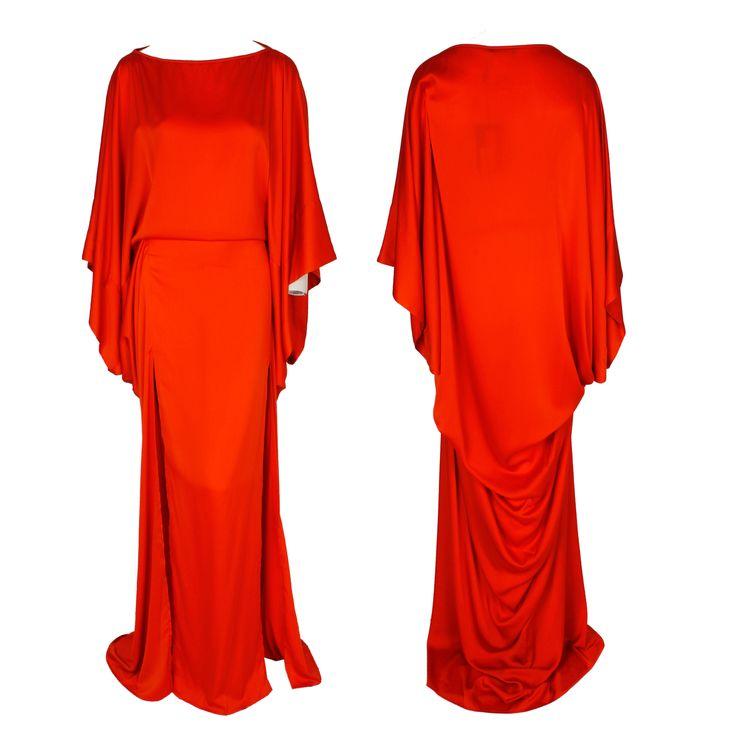 A red floor-length dress with a classic boat neck, side slit, and Kaftan sleeves by Plein Sud #pleinsud #ramadan #fashion #hautecouture #luxury #trend #kaftan #gbmoda #red #eveninggown #abudhabi #dubaifashion #greenbird #marinamall #elegance