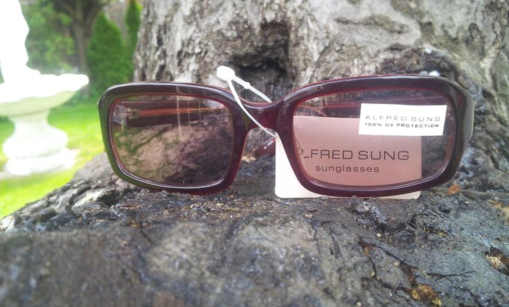 €30 These sunglasses have burgundy colored shades sunlenses.