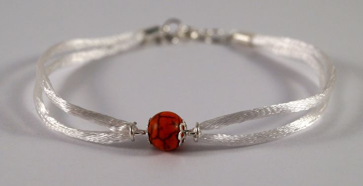 White bracelet with red howlite by TosTosia
